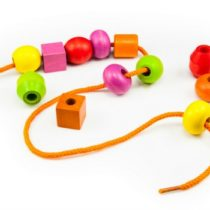 Wooden Beads on a String making a Colorful Toy Necklace