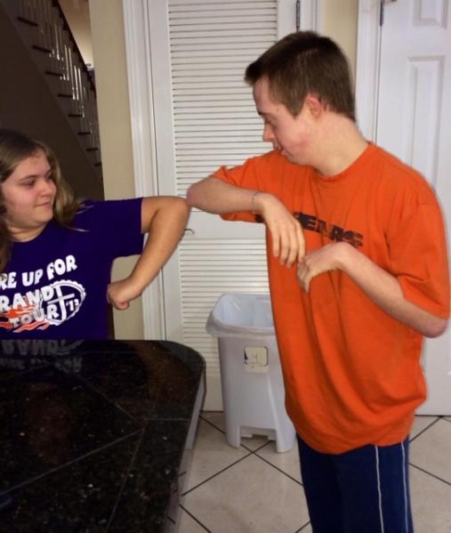 Nick and jenna elbow bump